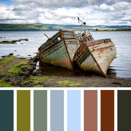 isles: Two abandoned fishing boats in Salen Sound, Isle of Mull, Inner Hebrides, Scotland. In a colour palette with complimentary colour swatches.