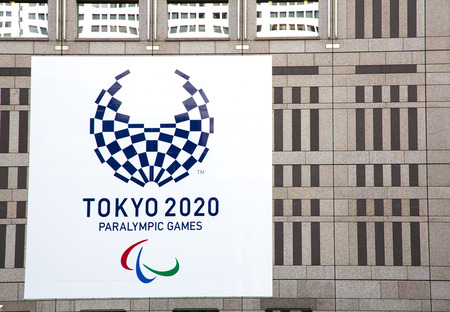 olympic symbol: TOKYO, JAPAN - June 23 2016: Posters shown on the Metropolitan Government Building as Tokyo prepares to take over the Olympic Games from Rio for the 2020 Games.  Tokyo, Japan 2016 Editorial