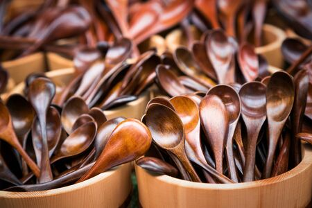 hardwoods: Japanese wooden spoons for sale at a market. A variety of styles in hardwoods with warm tones.