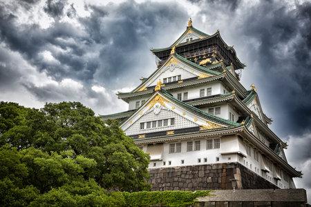 gathers: Storm gathers over Osaka Castle, Japan.