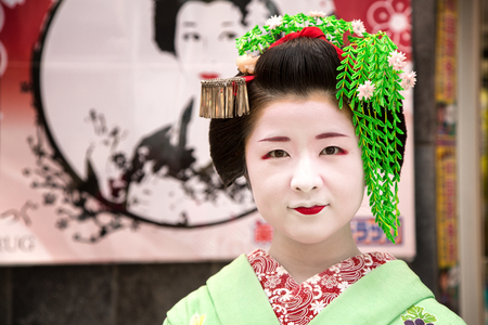 entertainers: KYOTO, JAPAN - June 16 2016: Geisha on the streets of Gion. In Kyoto, Japan 2016 Editorial