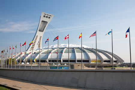 MONTREAL CANADA - SEPT 05 2014: A stitched panorama of the iconic Montreal Olympic Stadium.  Montreal hosted the summer Olympics in 1976, the first games to be held in Canada.