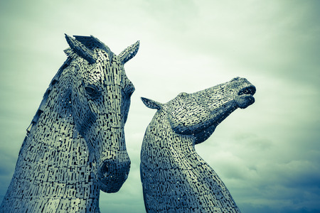 scott: FALKIRK, SCOTLAND - 27 JULY 2015: The Kelpies, Scotland by sculptor Andy Scott. At  30 metres high, these are  the biggest equine statues in the world.