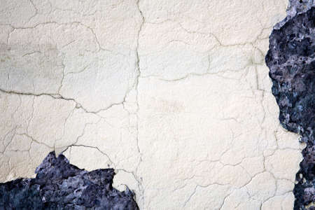 plasterwork: Damaged plasterwork on old wall. Background texture with space for text.