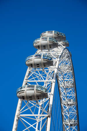 millennium wheel: LONDON, UK - 20th NOVEMEBR 2013: Detail of the London Eye Millennium Wheel, showing closeup of the passenger cars, with clear blue sky background.