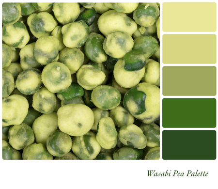 complimentary: A background of dried Wasabi peas, in a colour palette with complimentary colour swatches.