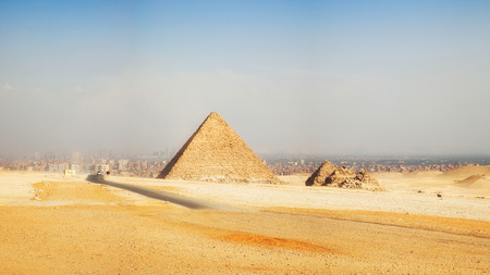 giza: Panorama of Pyramids, Giza, with the sprawling modern city of Cairo in the background. Stock Photo