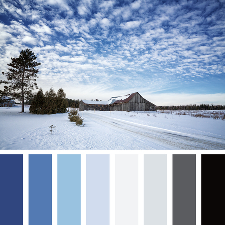 Old barn in the snow, Beauce, Quebec Province, Canada.  In a colour palette with complimentary colour swatches.