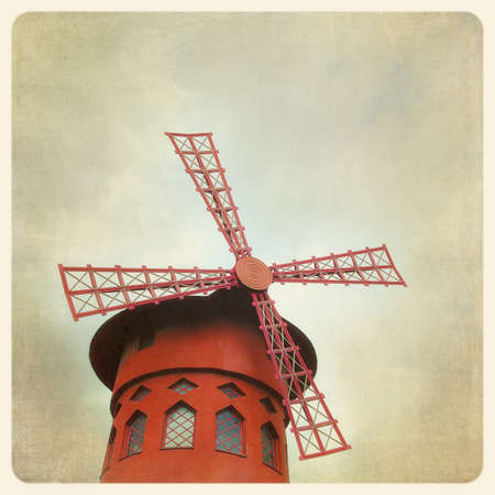 moulin: The famous Moulin Rouge in Paris, France. Filtered to look like and aged, instant photo