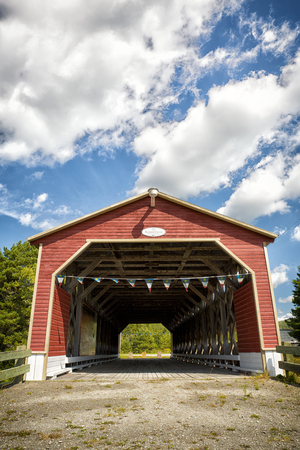 monument historical monument: The Pont Romain Caron, covered Bridge, in St John de la Lande, Temiscouata, Quebec province. Historical monument dating back to 1940.