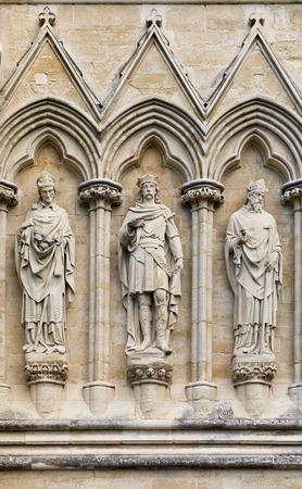 13th century: Statues of Saints on the exterior of Salisbury Cathedral, Wiltshire, UK. This Anglican Cathedral was built in the 13th Century, and these particular statues were sculpted by James Redfern and added in the 19th Century. Stock Photo