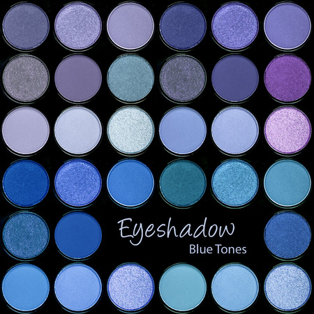 purples: A background palette of eyeshadows in cool tones of turquoises, blues and purples. Stock Photo