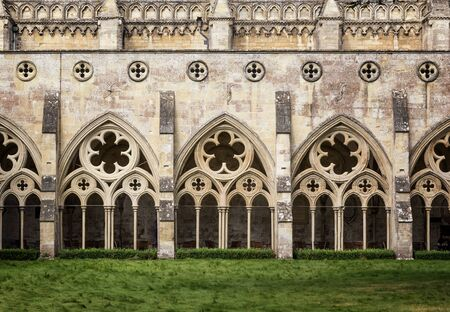 13th century: The cloisters of Salisbury Cathedral in Wiltshire, UK. This Anglican Cathedral was built in the 13th Century, and the cloisters are a covered exterior walkway in a quadrangle format. Stock Photo