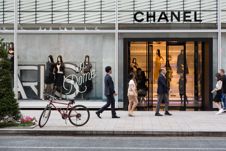 TOKYO, Japan - 24th June 2016: Shoppers pass by the French couture store Chanel in the expensive shopping district of Ginza. 에디토리얼
