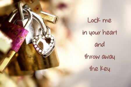 throw away: Love padlocks on a Paris bridge with the text Lock me in your heart and throw away the key. Valentine and love concept.
