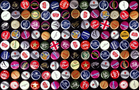 trademark: SOUTHAMPTON, UK - 21 Jan 2017: A background of bottle caps from a variety of popular beers, lagers and ciders from around the world.