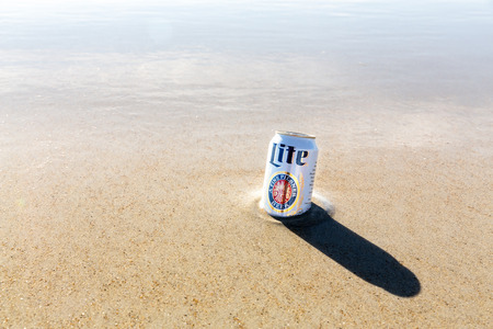 Old Orchard Beach, USA - 3rd Sept 2014: Illustrative editorial image of a can of Miller Lite beer being kept cold in the sea. Miller Lite is a popular pale light beer produced by Millercoors since 1973, and sold worldwide. Editorial