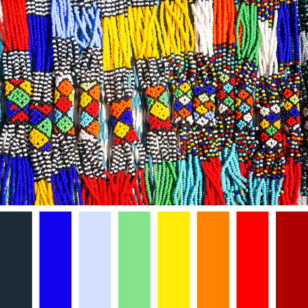 African tribal necklaces made from intricate bead work in bright colours.  In a colour palette with complimentary colour swatches. Stock Photo