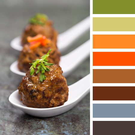 A trio of Asian meatballs in white ceramic spoons, garnished with peppers and pea shoots.  in a colour palette with complimentary colour swatches.