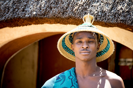 Lesedi Cultural Village, SOUTH AFRICA - 4 November 2016: Portrait of a young male Basotho tribesman. The Basotho, or Bantu tribe are mountain people originating from Lesotho.