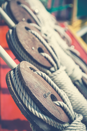 Ship pulley blocks and ropes closeup. Retro style, matte finish processing. Stock fotó