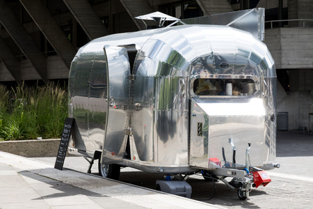 London, UK - 5 June 2017: Iconic Airstream Travel Trailer being used as a food truck on the South Bank of the Thames river in London, UK