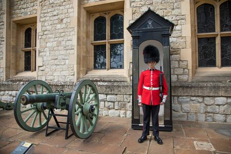 London, UK - 7 June 2017: Footguard of the Queen, in the traditional ceremonial summer dress uniform, at the Tower of London, UK.