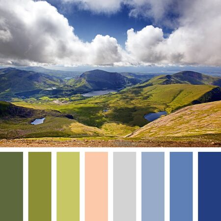 Scenic view of the mountains and lakes of Snowdonia, looking from Mount Snowdon from the Llanberis Pass, United Kingdom In a colour palette with complimentary colour swatches.