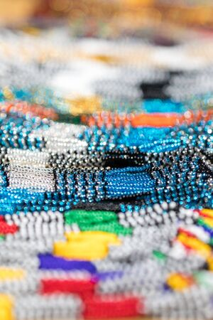 intentional: Glass bead necklaces for sale in an African market. These traditional tribal beads are sold all over Africa as souvenirs.  Intentional shallow depth of field.