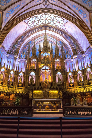 Montreal, Canada - 14 September 2017:  Interior of the Notre-Dame Basilica in the historic district of Old Montreal, showing the gothic revival main alter. Editoriali