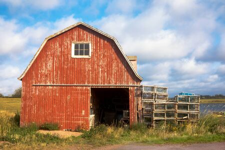 Old lobster barn on the Baltic River in summer, Prince Edward Island, Canada. Фото со стока