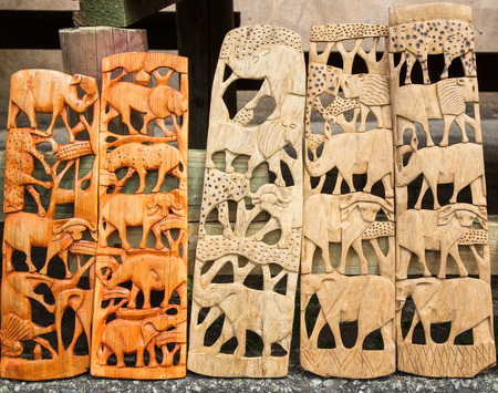 African tribal art of the big five animals of South Africa, for sale at a market stall. This artwork is generic and widely available across markets in South Africa.