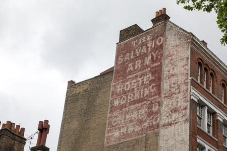 London UK - 5th June 2017: Advert, on the brick facade of a London Building, for The Salvation Army, a chartable organisation founded in the East End in 1865, to provide shelter for the homeless