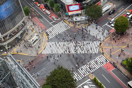 Tokyo, Japan - 26th June 2016: Ariel view of the busy Shibuya Crossing, known as The Scrambles, where upwards of 1000 people cross the street every time the lights change. Editorial