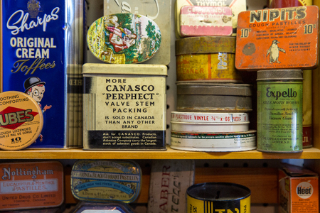 Quebec Province, Canada - 25th January 2015: A stack of old product tins for sale in a flea market, including sweets and medicines. Editorial