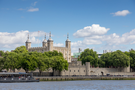 The famous White Tower and the Tower of London, as seen from Southbank across the River Thames.  Popular historical tourist attraction on a summer day. Reklamní fotografie