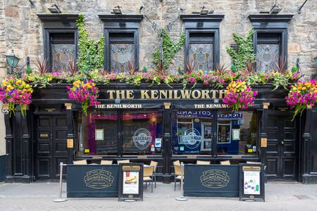 Edinburgh, Scotland - 9th August 2015: Traditional Scottish pub, The Kenilworth, in Ediburgh, Scotland. Historical Victorian building with Arts and Crafts style stained glass windows.