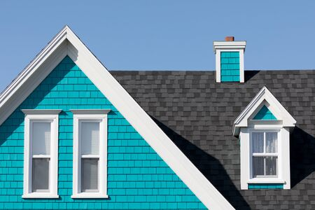 Detail of the typical style of colourful houses in Iles de la Madeleine, or the Magdalen Islands, Canada. Minimalistic style in blue, white and turquoise with space for text.