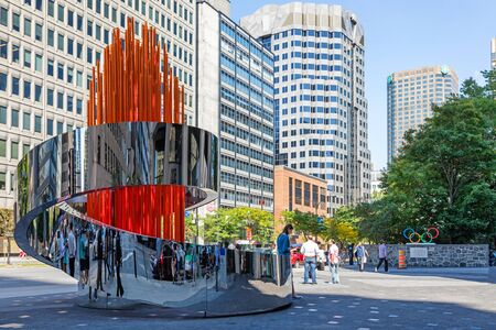 Montreal, Canada - 14th September 2017: The Olympic Torch sculpture on the plaza of the Canadian Olympic headquarters in downtown Montreal, Rene-Levesque Blvd. Horizontal format.