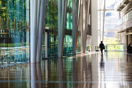 Montreal, Canada - 14th September 2017: The Palais des Congres, or Palace of Congress, in downtown Montreal, Canada. A womon is walking through the vast hallway of this Internationl Conference Centre. Archivio Fotografico - 134905077