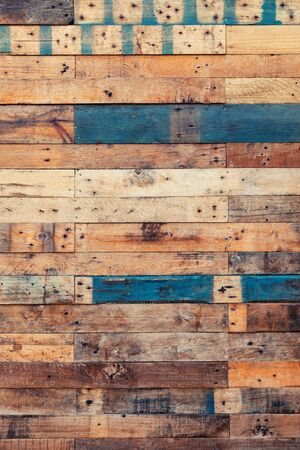 Grunge wood background in natural shades with blue. Rustic style rough planks with nails, holes and a variety of shades and textures. Portrait format.  Zdjęcie Seryjne