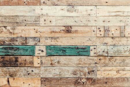 Grunge wood background in natural shades with turquoise. Rustic style rough planks with nails, holes and a variety of shades and textures.