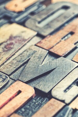 Vintage wooden letterpress blocks background with retro style processing