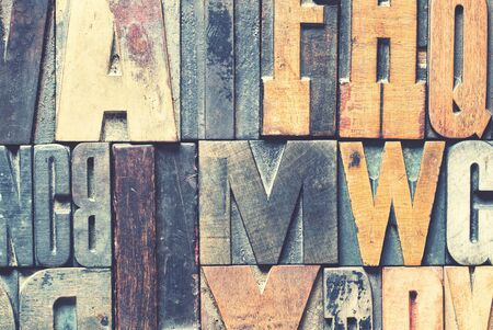 Detail of vintage wooden printing blocks with retro style processing.