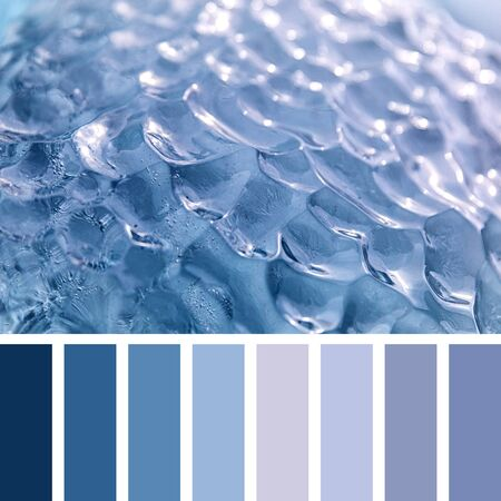 Closeup of blue glacial ice in the arctic ocean, Svalbard, in a colour palette with complimentary colour swatches. 스톡 콘텐츠