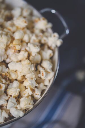 Fresh popcorn in a bowl with retro style matte processing. 스톡 콘텐츠