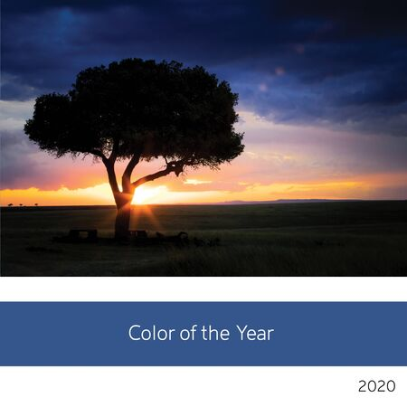 Color of the year 2020. View of a lone tree in the Masai Mara, Afriica, with sunset sky in classic, orange and blue tones.