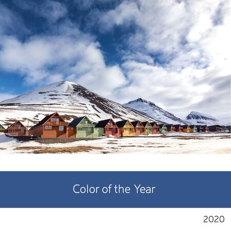 Color of the year 2020. View of the colourful houses of Svalbard with mountains, puffy clouds and sky background in classic, rich blue tones. 스톡 콘텐츠