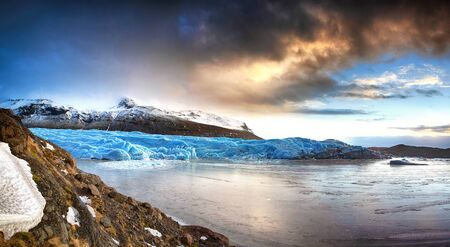 Panorama of the tongue of the Svinafellsjokul glacier in southeast Iceland at dusk. This is the largest ice cap in Europe.