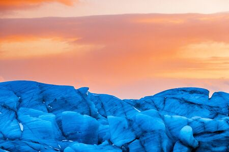 Detail of the blue glacial ice of Svinafellsjokul glacier in southeast Iceland at sunset. This is the largest ice cap in Europe.
